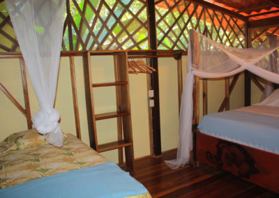 Airy upstairs bedroom of our Deluxe Bungalow, Casa Colibri
